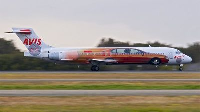 Jetstar Airways (JP) Boeing 717-231 VH-VQJ aircraft, with the sticker ''AVIS-we try hard'' on the airframe, departs early in the morning Australia Brisbane primary International Airport. 28/08/2005. (Avis=an Ameican car rental company).