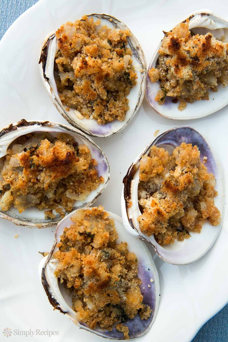 Baked Stuffed Clams ~ Minced clams mixed with butter, onions, parsley, and bread crumbs, spooned into half clam shells and baked. Quahog Stuffies recipe. ~ SimplyRecipes.com