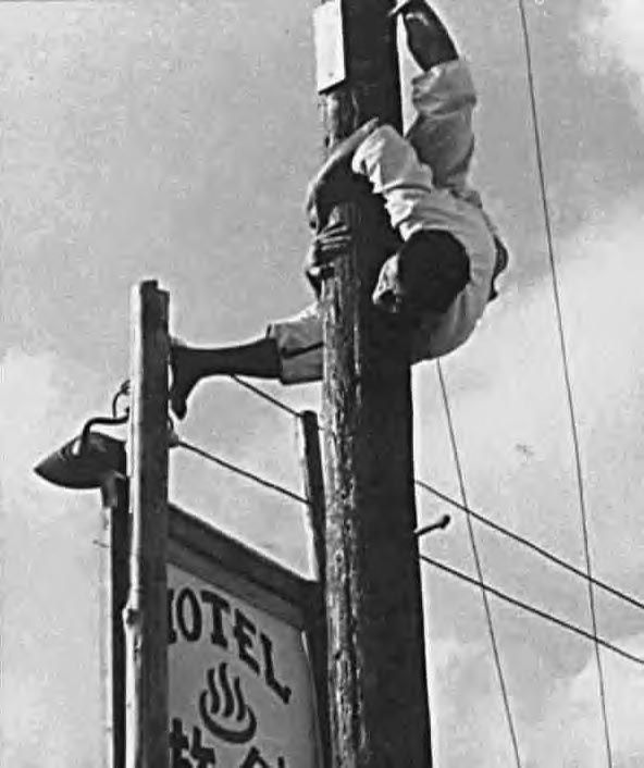 Grand Master Tatsuo Shimabuku, founder of Isshinryu karate, scales power pole, reaches top and heads down, head-first!