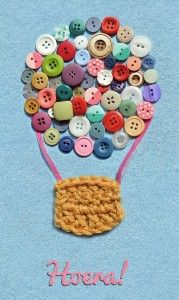 A baby announcement card made of buttons