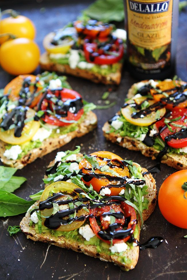 Avocado, Tomato, and Goat Cheese Toast-avocado toast with tomatoes, goat cheese, arugula, basil, and a drizzle of balsamic glaze. The perfect avocado toast for summertime.