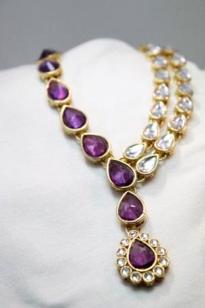 Purple and gold kundan set