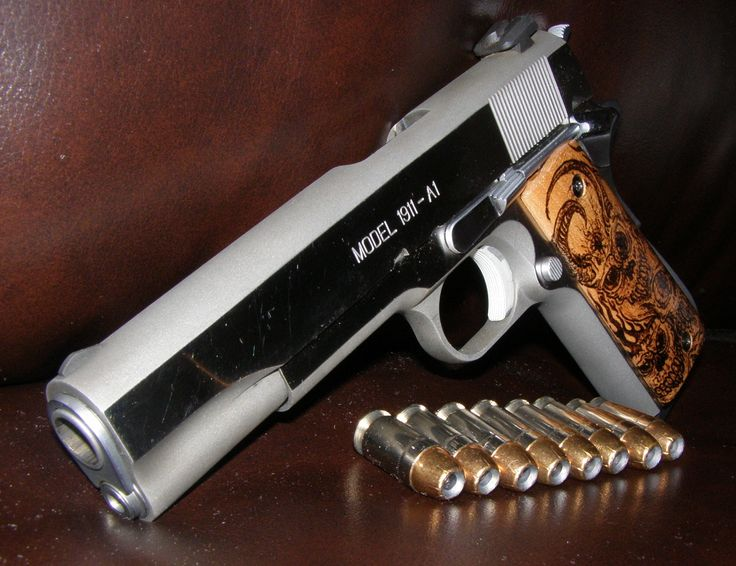 Custom 1911 Grips by Clay Bradshaw -  Find our speedloader now!  http://www.amazon.com/shops/raeind