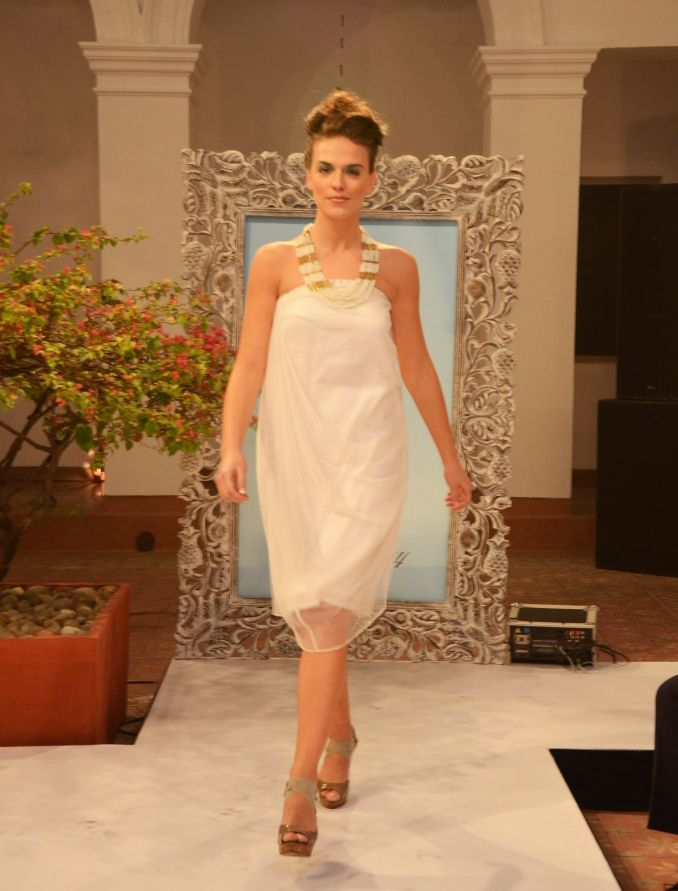 White crepe-and-net draped cowl off-shoulder dress (INR 3390)