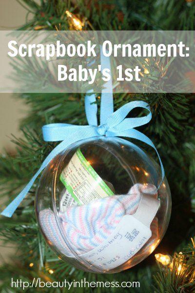 Babys 1st Christmas Ornament--Fill a large plastic globe with newborn items to create a cherished keepsake 1st Christmas ornament.