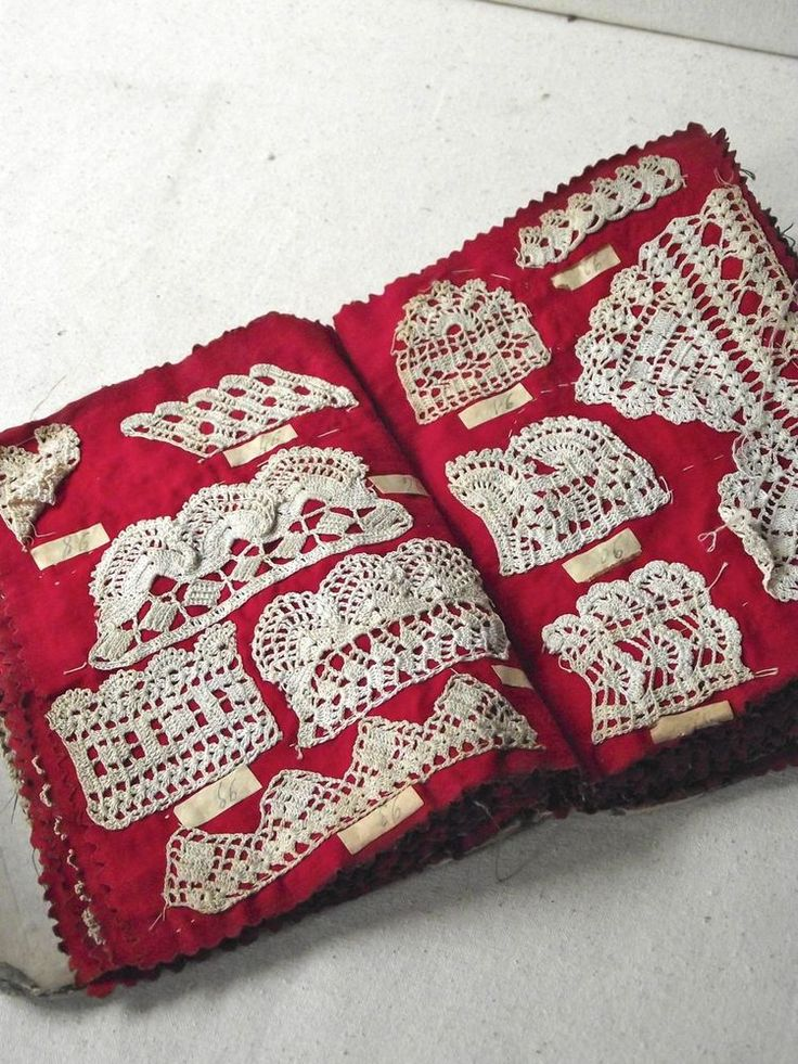 Sampler Book - Belgium  Hand made antique Belgium lace samples or examples. Sampler books were popular from the late 1800s to the early 1900s. Some were made by young girls in convents learning lace skills from the nuns. The handwork is very, very fine. Each piece is basted onto cloth pages.