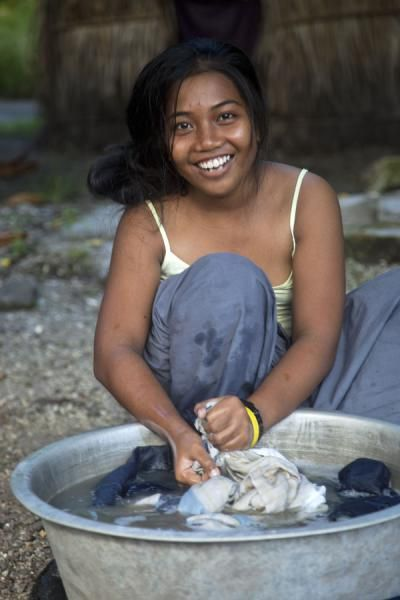 Even doing the laundry can be fun for this girl on North Tarawa | I-Kiribati people | Kiribati