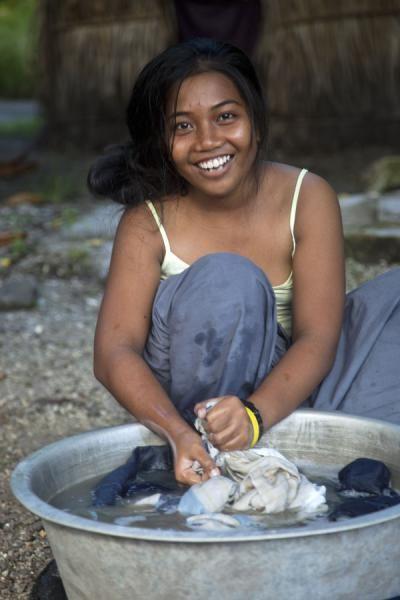 Even doing the laundry can be fun for this girl on North Tarawa | I-Kiribati people | Kiribati