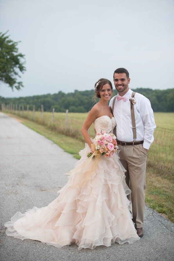 Love her dress, and the groom looks cute in his suspenders.