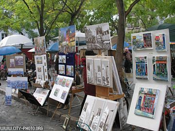 Taylor and Dmitri selling their paintings on the street in Montmartre