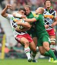 Harlequins' Nick Easter is caught by the London Irish defence