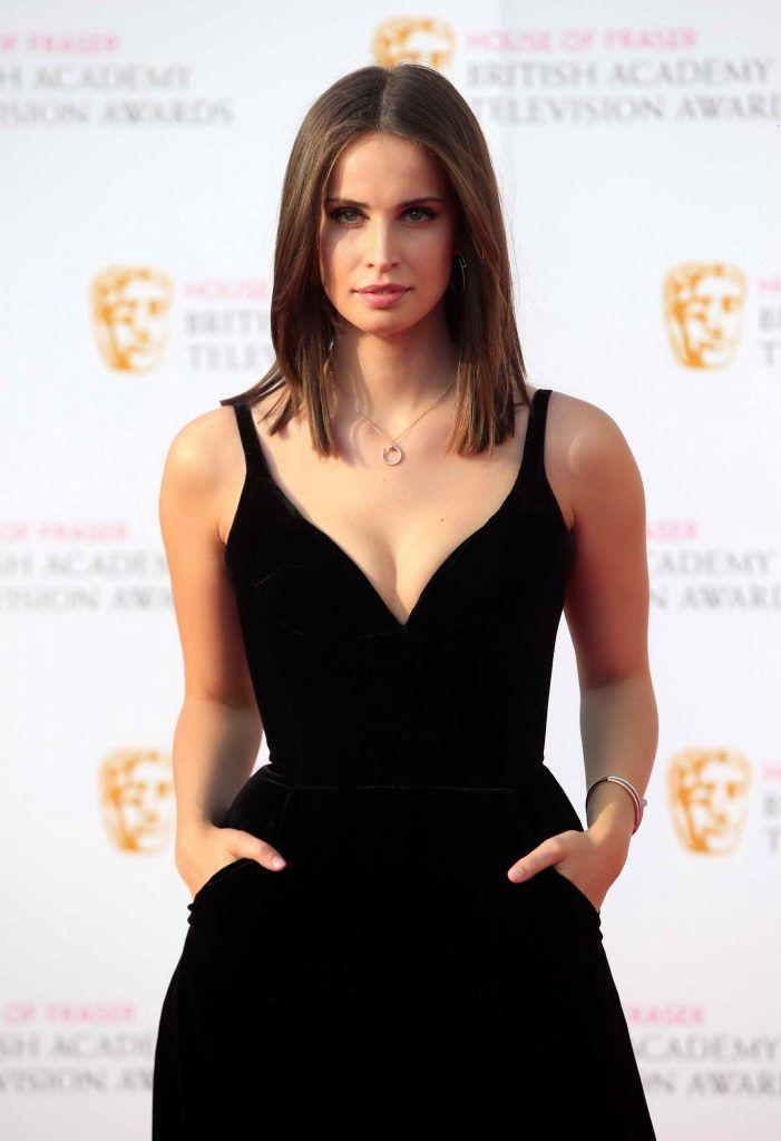 Heida Reed wears Ong-Oaj Pairam couture  velvet jumpsuit on the BAFTA red carpet
