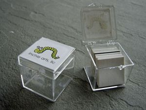 """Inchie Box $1.59 It is a 1.25"""" clear acrylic cube with hinged lid & Inchie Arts logo on top.The Box holds about 12 to 20 Inchie Squares depending on whether they are flat or 3D."""