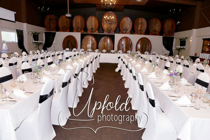 Elegant setup of a wedding at Langtons On Lincoln, in Henderson, NZ, showing a White, Purple and Black theme and decor. Image by Upfold Photography, Auckland, NZ www.upfoldphotography.co.nz.