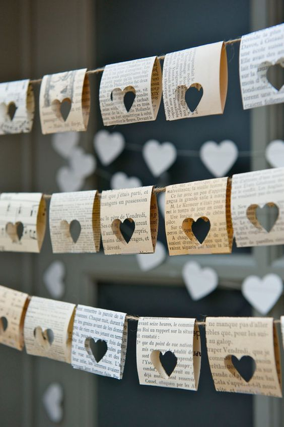 Punch heart shapes through old book pages to create this pretty bunting! Image: Pinterest