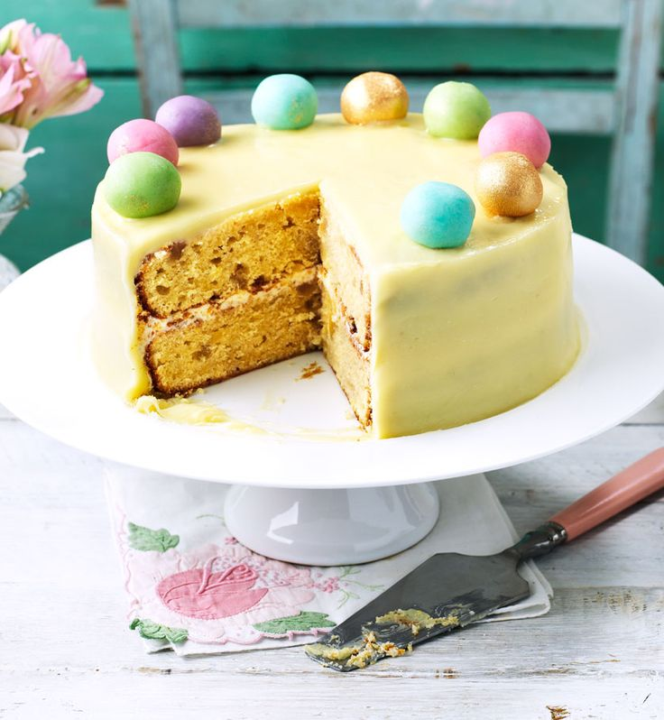 Try a modern twist on the classic Easter simnel cake. A blend of lemon and ginger complements the creamy white chocolate icing and moist cake, plus the colourful decoration mean it's a real showstopper!