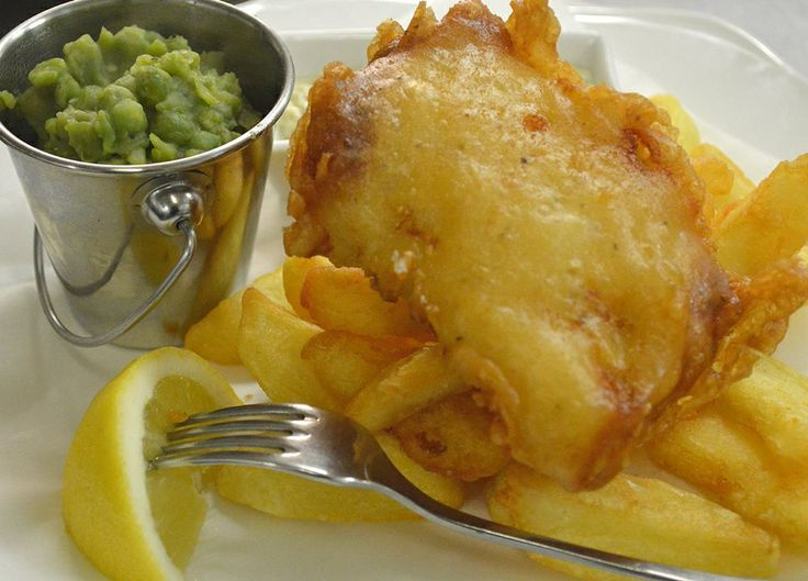 Battered fillet of Cornish cod, mushy peas, triple cooked chips, tartare sauce  at Milebrook House Hotel Restaurant near Knighton on the borders of Powys, Shropshire & Herefordshire.