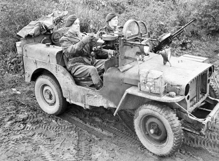 A British SAS Willys MB Jeep manned by soldiers of the 1st SAS near Geilenkirchen, Germany, 18 November 1944. The Jeep is armed with three Vickers K guns and is fitted with armored glass shields.  The Special Air Service was a unit of the British Army during WWII, formed in July 1941 by David Stirling. In 1944 the SAS Brigade was formed from the British 1st and 2nd SAS, the French 3rd and 4th SAS and the Belgian 5th SAS. It was tasked with parachute operations behind the German lines in…