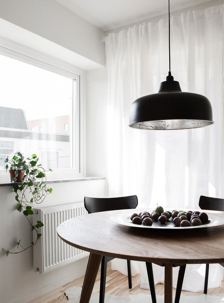 Table Setting Ideas - Large Black Pendant over Dining Table with Fruit Bowl on Table