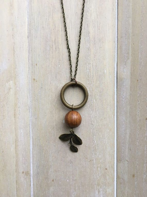 Long brown bronze colored necklace with beaded pendant.
