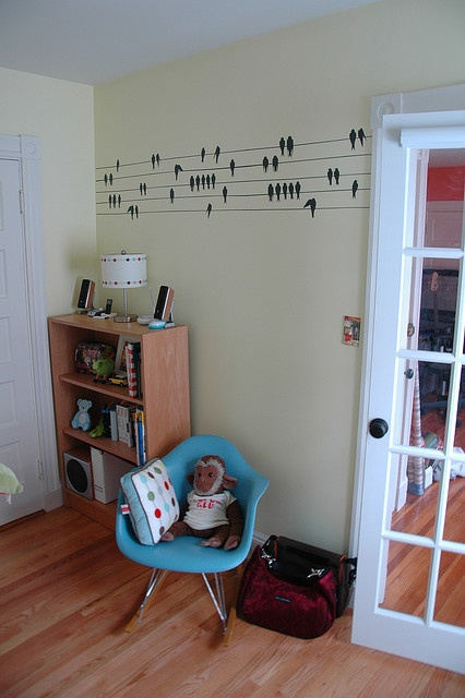 blue rocker with wall decal