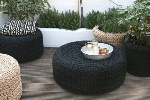 Handmade and designed for outdoor use, the tough crocheted polyester cord is UV-resistant. The different shaped low poufs are made from the crocheted cord being stretched over a rubber tire! The coordinating planters cover up plastic pots.