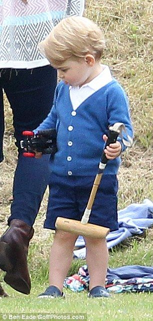 Is our future King really a leftie? Prince George 'prefers using his left hand'... just like his father William