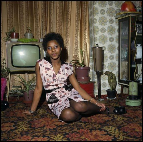 Front room, Brixton, 1969. Photograph by Neil Kenlock from The West Indian Front Room: Memories and Impressions of Black British Homes