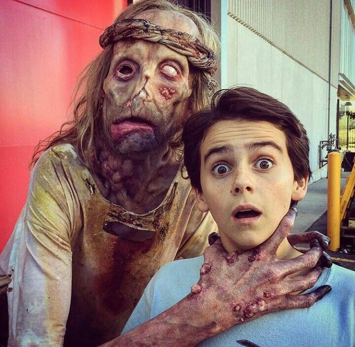 In this behind the scenes photo from Stephen King's IT (2017), Javier Botet as the Leper and Jack Dylan Grazer as Eddie Kaspbrak. Studio ADI designed the makeup and creature effects for the movie.