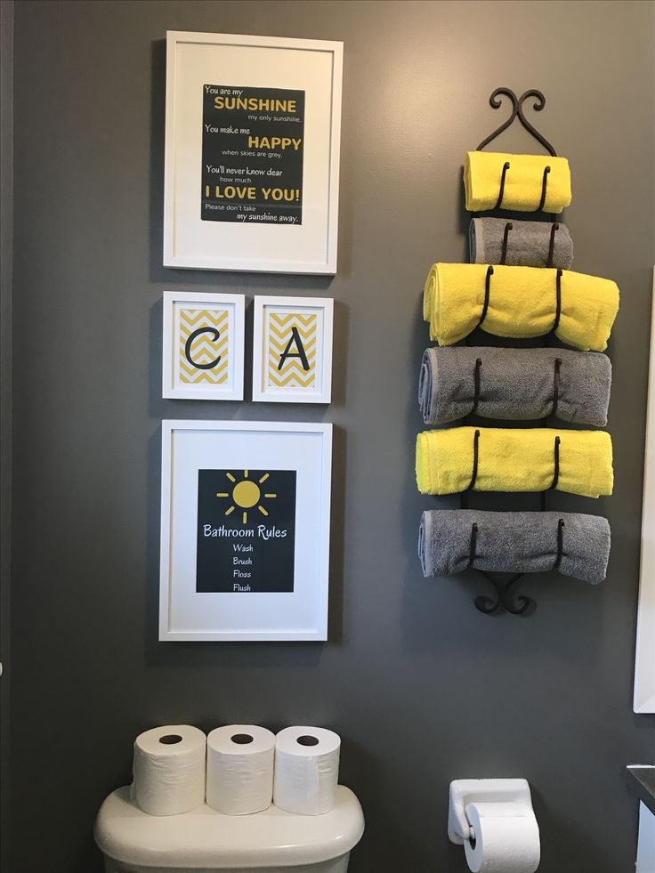 DIY kids bathroom. Paint: Chelsea grey Benjamin Moore Towel: yellow and grey from Ikea Photo frames: IKEA and photos were created using Canva