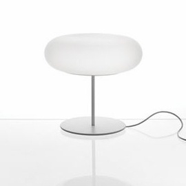Itka Table Lamp with base.                         Design by Naoto Fukasawa, 2008.  By Danese Milano.    The Itka series of lights features a simple and iconic shape that diffuses energy-saving fluorescent light uniformly without generating shadows on the opaline surface.