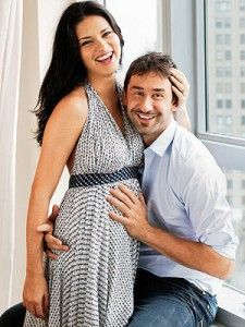 Maternity pose. Adriana Lima and her husband.