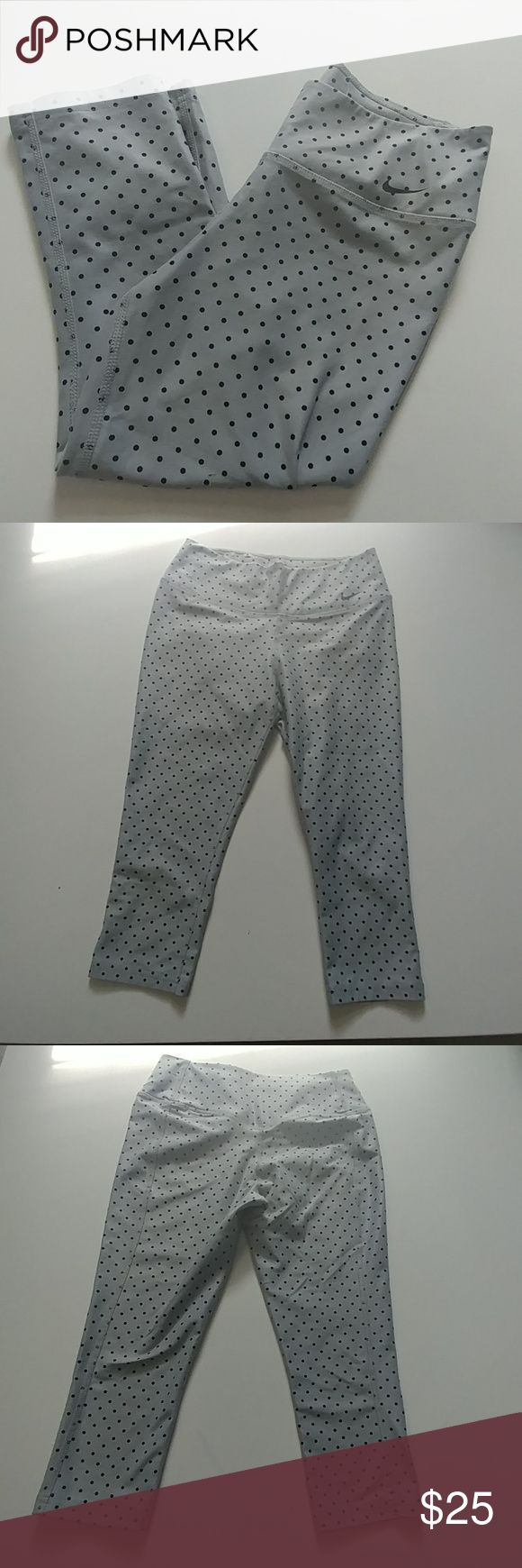 """Nike Dri Fit Capri Tights sz Small Gray Capri w black polka dots running tights from a a smoke and pet free home No damage flaws or defects Pocket inside waistband Ten less plastic bottles technology 88% recycled polyester/ 12% spandex sz small Approx Measurements  Waist 12.5"""" Rise 8.5"""" Inseam 17"""" Nike Pants Leggings"""