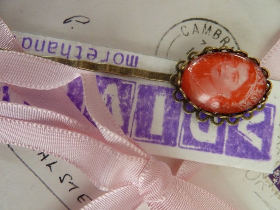 Red Queen Liz postage stamp hair clip by morethandivine on Etsy, £3.00