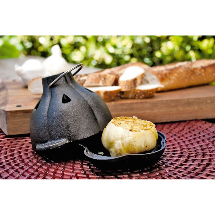 Garlic Roaster | Buy from Gardener's Supply  On the grill or in the oven, this cast iron roaster transforms a head of garlic into a fragrant, savory-sweet paste that's ready for spreading on crusty bread, tossing with pasta or kicking up the flavor of soups and casseroles.
