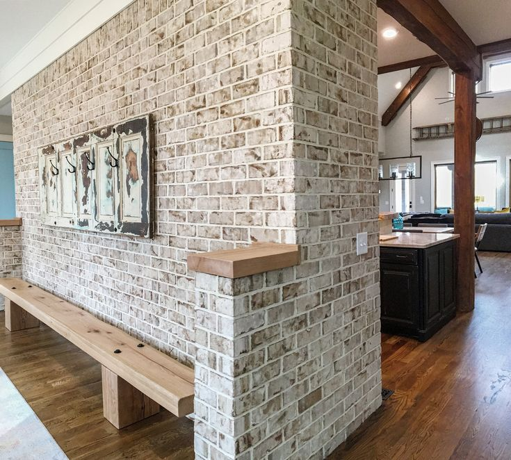 Elegant Interior Brick Wall On Foyer. Brick Tiles Were Used To Add Authentic Rustic  Charm To This Home. Brick Are Real Brick Not Fake Concrete Knock Offs.