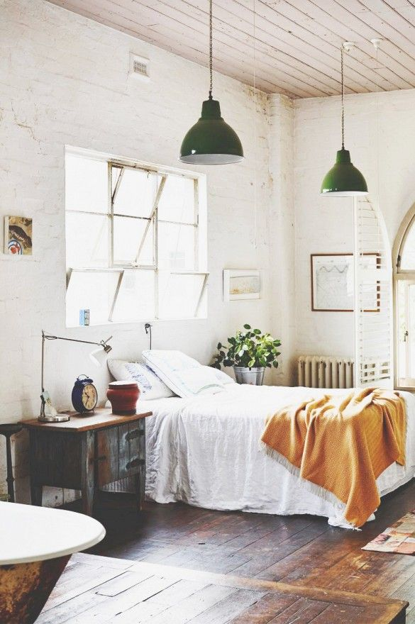 And love the bedside table approach  And the scale of the clock     A Melbourne Warehouse Gets an Artistic Makeover