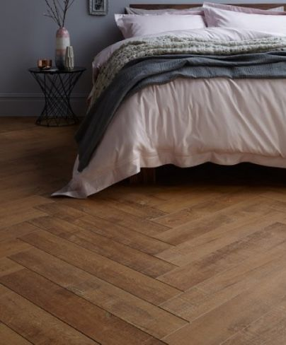 Oakhurst is a unique herringbone laminate that makes it easy and affordable to install herringbone flooring in the home. The laminate features embossing and a w...