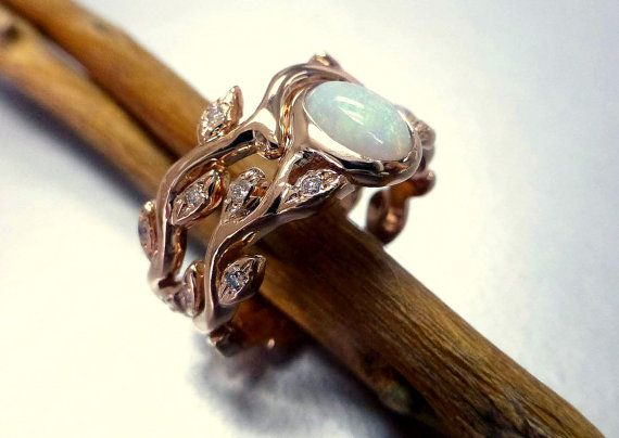 Engagement ring with opal and diamonds.  Leaf by ValerieKStudio, $1385.00 imagine this but with aquamarine in the middle. Mine (and hopefully my future husbands) birthstone.