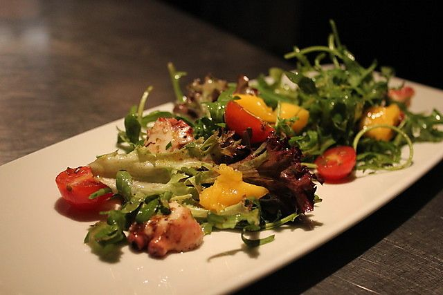 Fresh octopus salad with cherry tomato & rocket