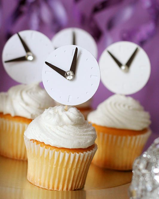 Cut circles out of paper to create clocks for your cupcakes. | 51 DIY Ways To Throw The Best New Year's Party Ever
