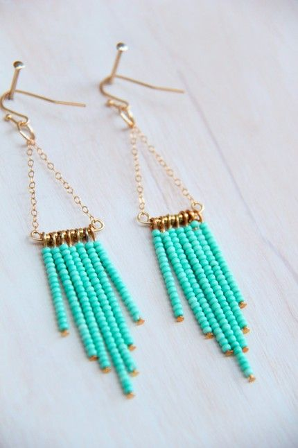 Beautiful light-teal drop earrings made of soft chain, seed beads jump rings. Would love to make something as bohemian and beautiful one day.