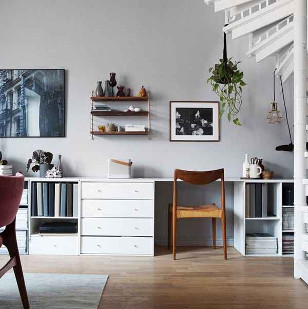 Wooden shelfving and chair, white soft grey elements and walls, office, scandinavian