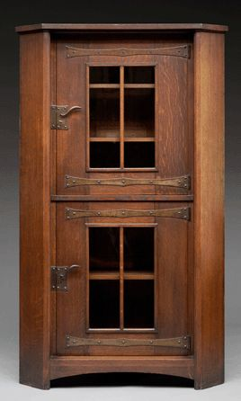 Replacing the Victorian predilection for decorating with a miscellany of fancy objects, Gustav Stickley opted for designs in plain, straight lines that were adaptable for Craftsman settings. This oak, iron and glass corner cupboard was executed around 1902–1903 in Stickley's favorite brown color, achieved by applying wax or a thin coat of shellac to give the wood a soft, lustrous glow. Private collection. —All photos courtesy of Dallas Museum of Art.