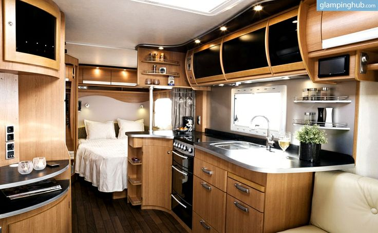 Luxury Caravan Camping in Denmark | Glamping in Denmark. This caravan is brand new and quite luxurious. It has six beds, kitchen, toilets and a huge awning with fixed, solid floors, fully equipped kitchen, flat screen and garden furniture.