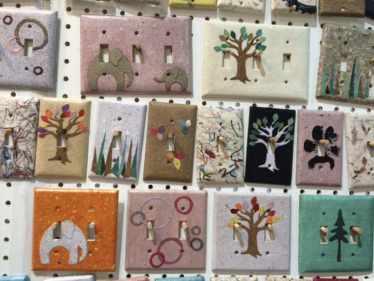 Light switch covers covered with handmade papers, Julia Garretson