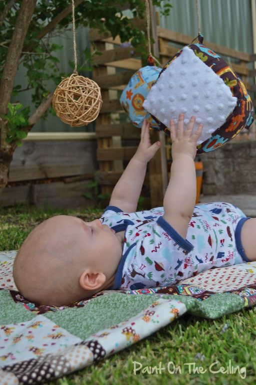 Baby Play - Hanging Objects; love the idea of taking the baby out and hanging things from the trees for him to try to grab.