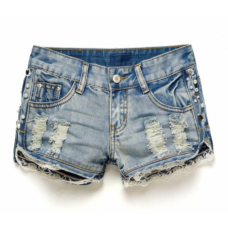 Los delgados del nuevo verano de los cortocircuitos del dril de algodón de cuentas femenino caliente cortocircuitos ocasionales de los pantalones vaqueros de la borla de las mujeres pantalones cortos de mezclilla metal libre de la
