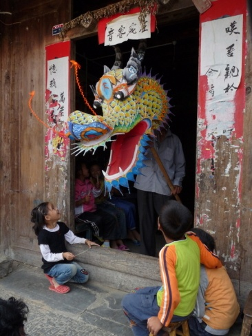 A Dragon Emerges from a Dragon Maker's Shop, Beijing, China