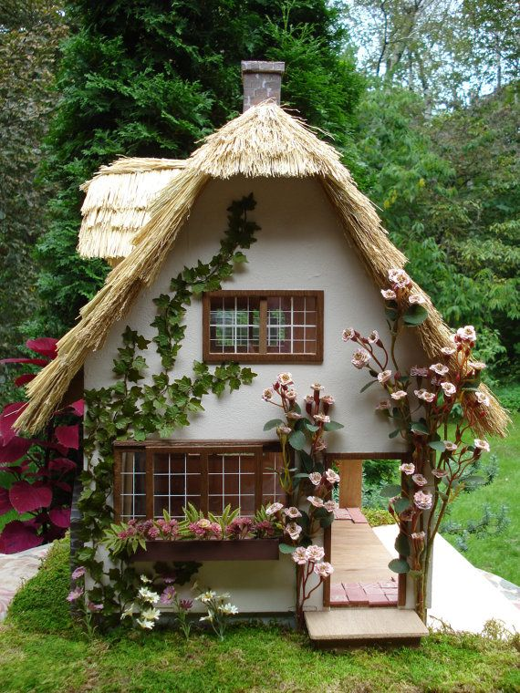 Thatched Doll House Lulling Woods Cottage by LovelyDayForAPicnic.  Really like the creeping ivy
